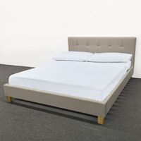 Double bed, Upholstered in Cream fabric- with Wooden feet